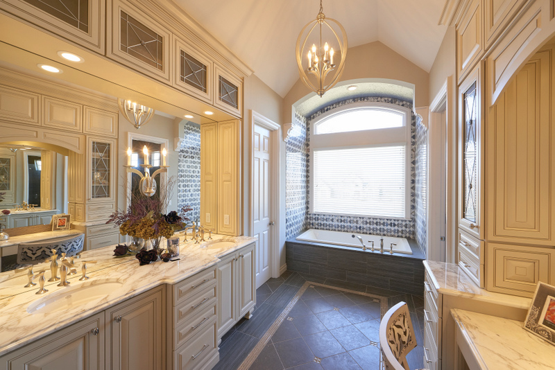 Bathroom design with window over tub
