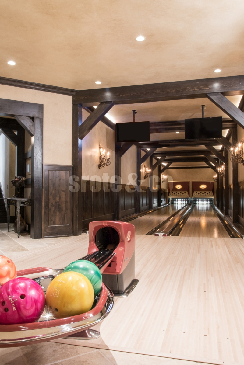 Home bowling alley design in basement