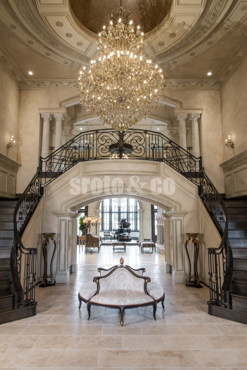 Foyer design with dual staircase
