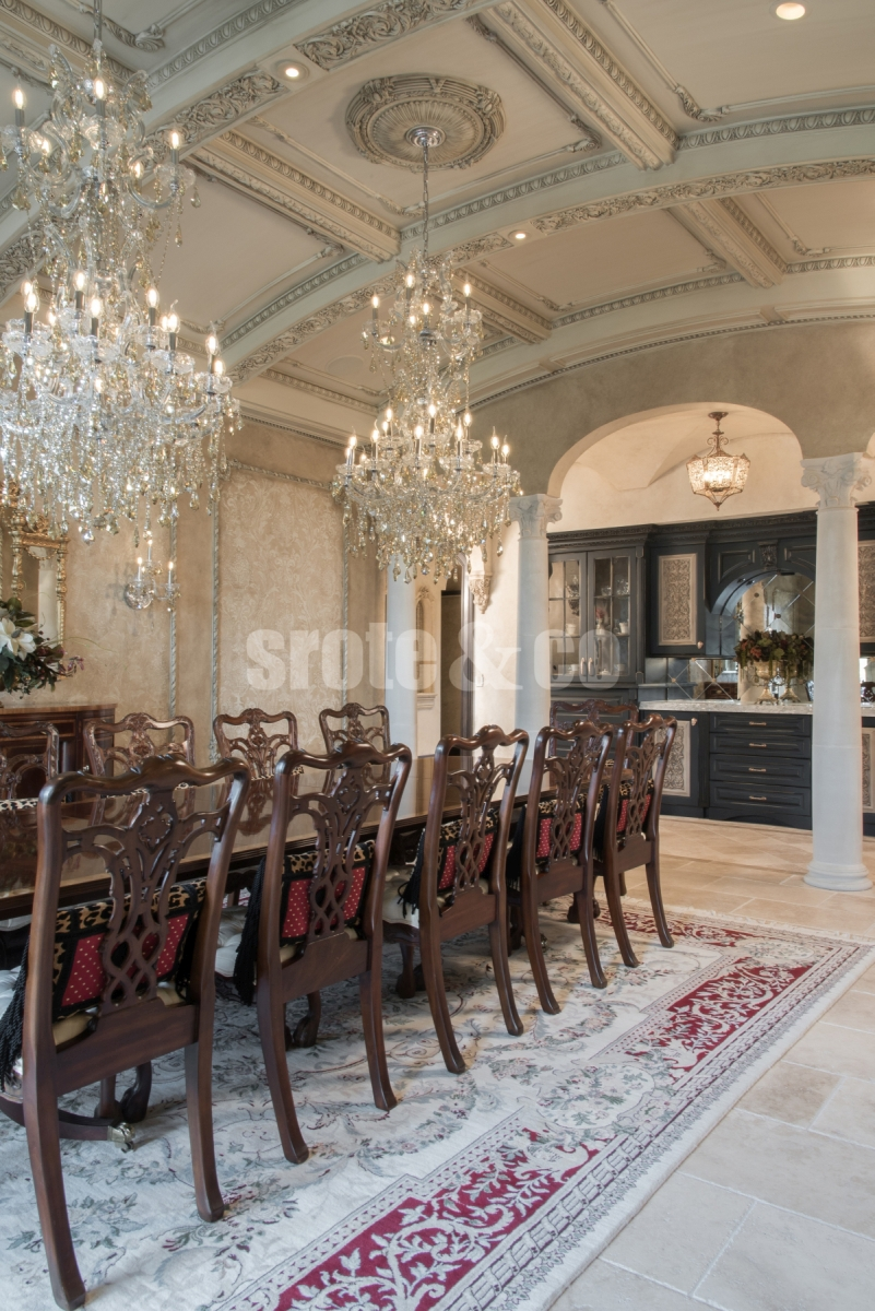 Dining room design with arched coffered ceilings